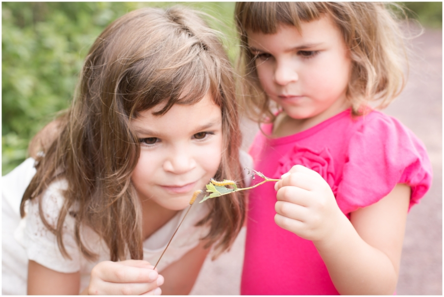 photo of girls looking at caterpillar in Northern Virginia