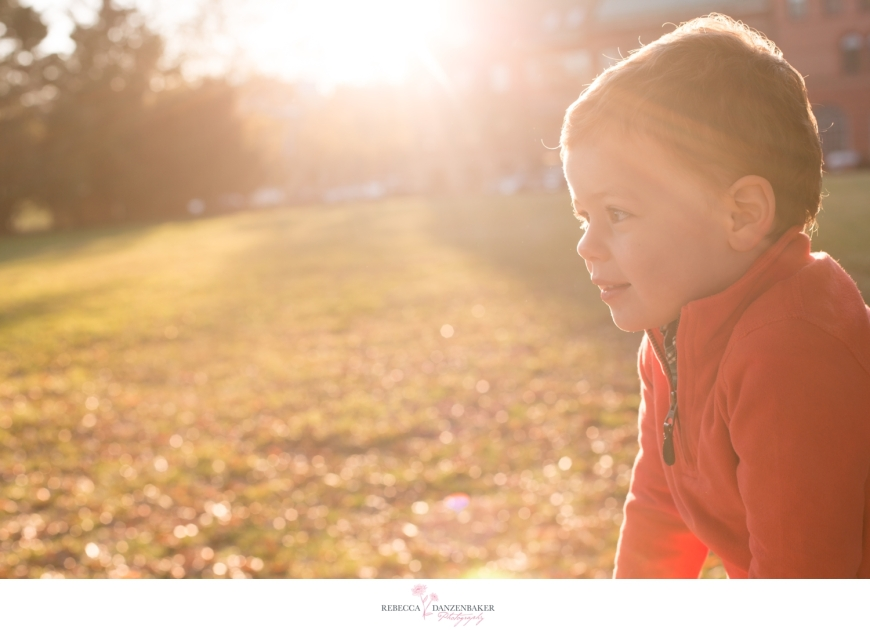 Photo of boy in field with sun flare
