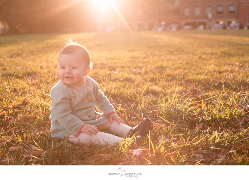 Photo of one-year-old girl in a field