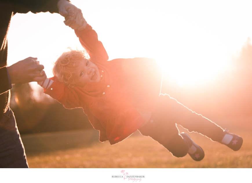 Photo of girl flying through the air with sun flare