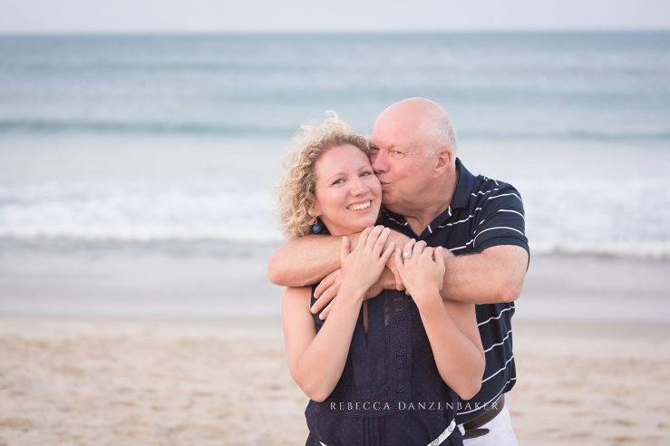 father and grown daughter photography on the beach