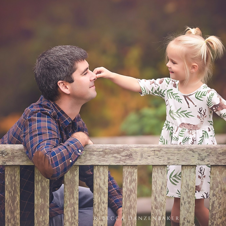 girl pinching her father's nose in family photography by Rebecca Danzenbaker