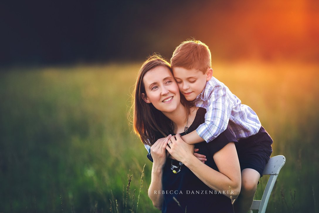 mother and son hugging outside family photo